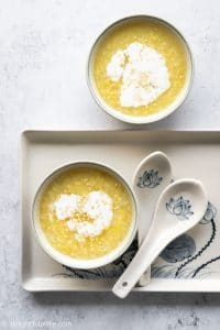 Vietnamese Mung Bean Pudding (che do xanh), a sweet dessert soup featuring split mung bean. It can be served with sticky rice and coconut milk.