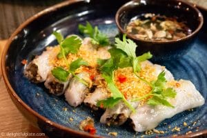 Vietnamese steamed rice rolls with fillings (banh cuon nhan)
