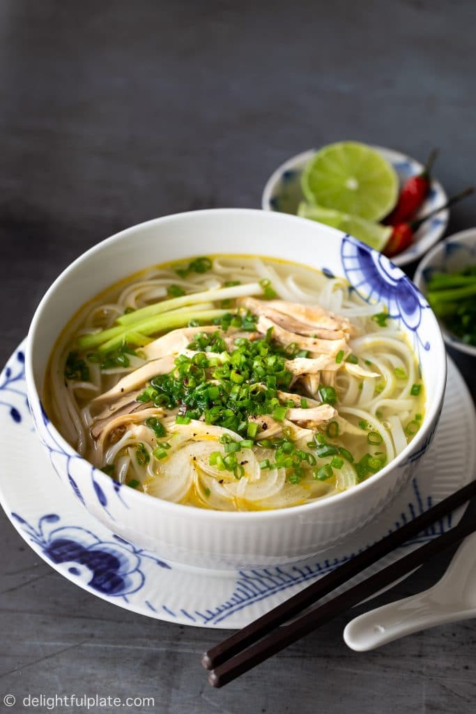 Traditional Pho Ga Hanoi (Vietnamese Chicken Pho Noodle Soup) with tender chicken and light fragrant broth. It can be cooked on the stovetop or in a pressure cooker.
