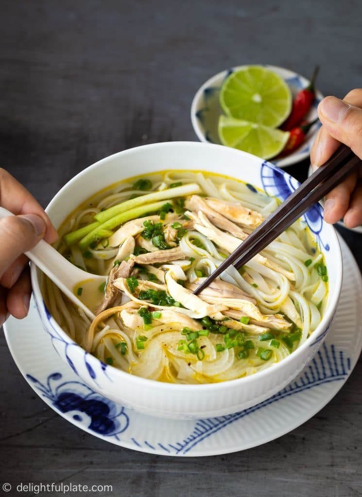 A bowl of comforting Pho Ga (Vietnamese Chicken Noodle Soup) with slippery noodles, tender chicken and fragrant broth. Easy to make in just over an hour.
