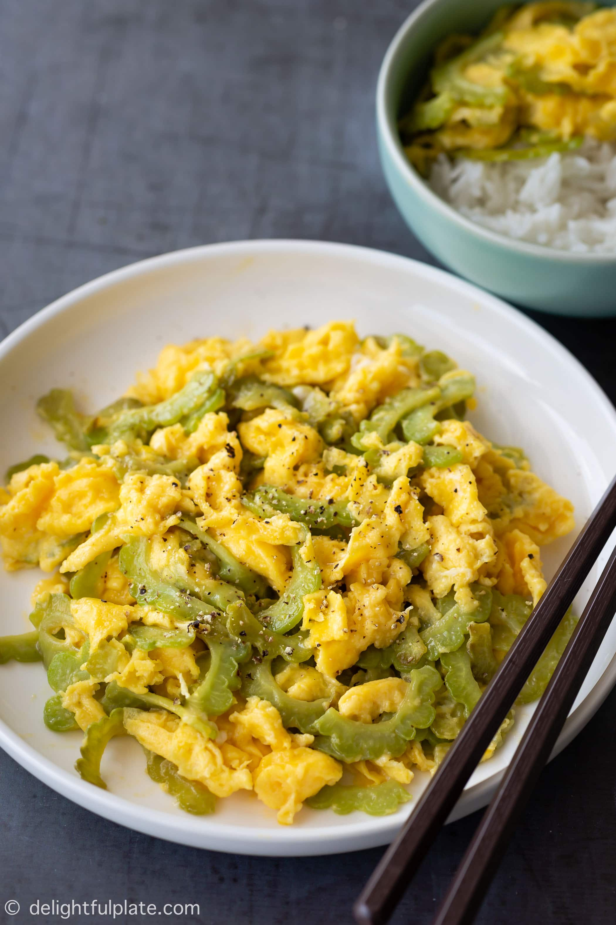 A plate of Vietnamese Bitter Melon Stir-Fry with Eggs (Muop Dang Xao Trung). This is a quick and easy dish with health benefits. It requires very few ingredients and you need just one pan to cook it.
