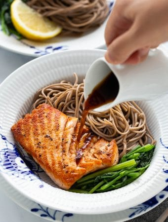 This Pan-Seared Salmon Soba Noodle Salad features moist medium-cooked salmon fillets with crispy skin over soba noodles and vegetables. Served with a ginger dressing, this delicious and healthy salad can be a full meal that is ready in under 30 minutes.