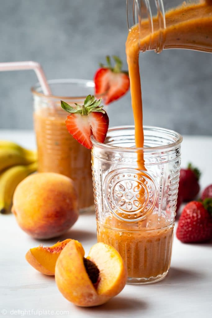 Thick and creamy strawberry peach smoothie made with strawberry, peach, banana, pineapple, mango, mint and parsley. A very refreshing, tasty and healthy breakfast smoothie.