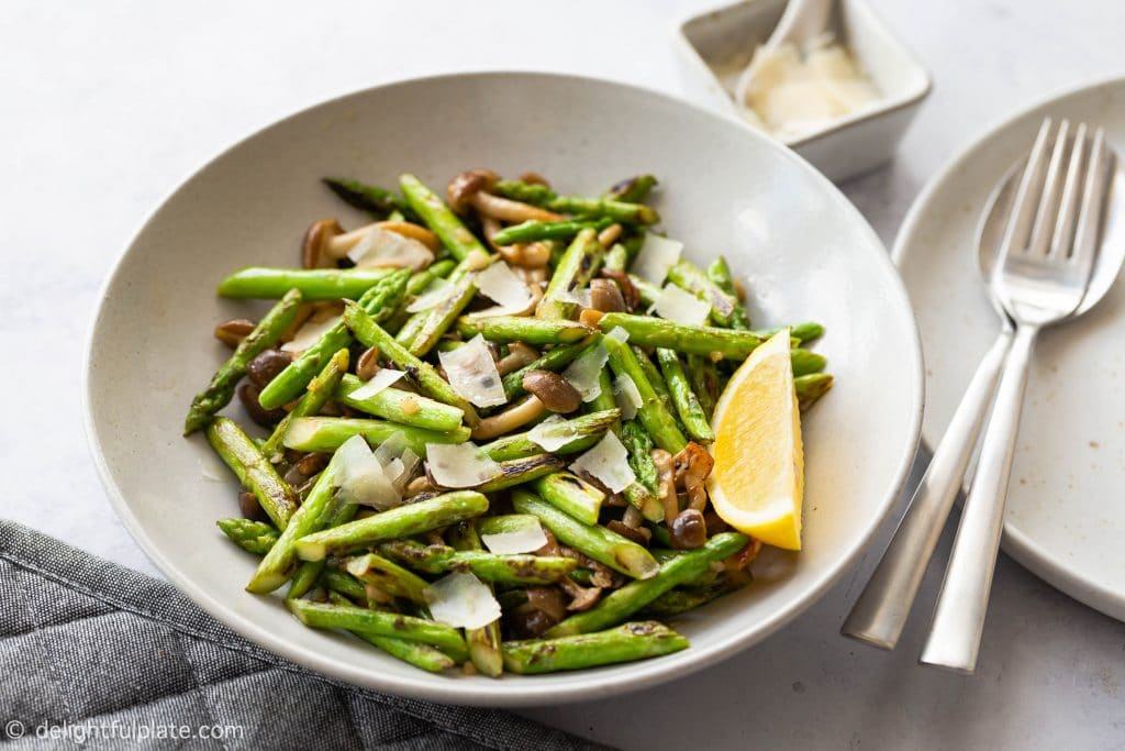 Sautéed Asparagus with Mushrooms, a healthy and easy vegetarian side dish. All you need is 15 minutes and one pan to put it together.