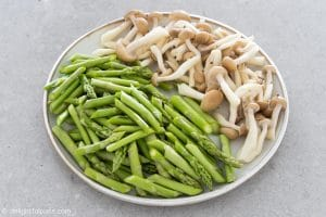 Sliced asparagus and shimeji mushrooms