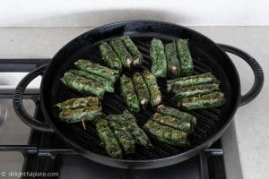 Grilling Vietnamese beef in wild betel leaves (bo cuon la lot)