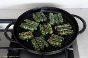 Grilling Vietnamese beef in wild betel leaves (bo cuon la lot)