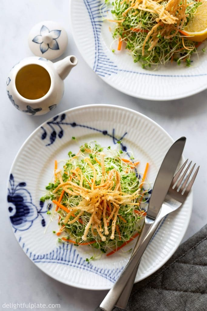 This healthy and tasty Microgreens Salad features nutritious microgreens, crunchy carrots, crispy fried enoki mushrooms and a bright lemon vinaigrette. It is vegan, dairy-free and gluten-free.