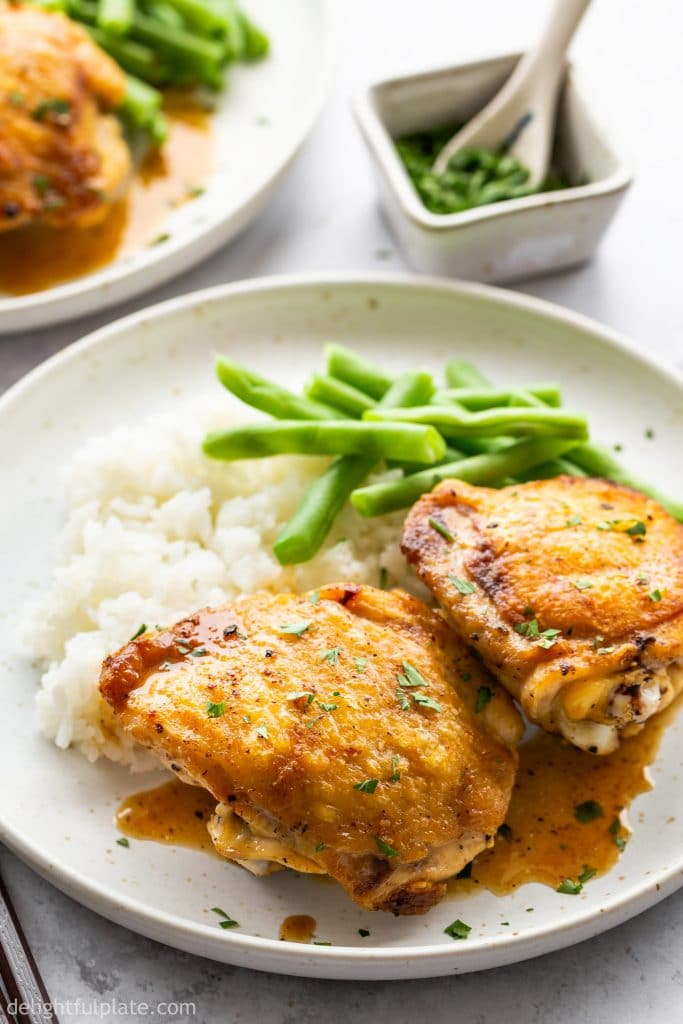 Pan Roasted Chicken Thighs with crispy skin and juicy meat. Serve with a velvety pan sauce and vegetables. It's are unbelievably quick and easy to cook these thighs.