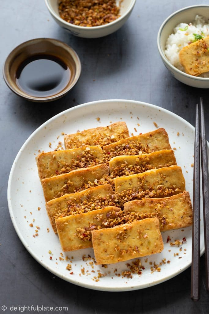 Vietnamese Lemongrass Chili Tofu (Dau Hu Chien Sa Ot) is a vegan dish with crispy fried tofu marinated with lemongrass and bird's eye chili.