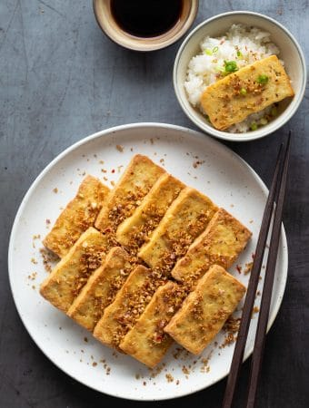 Vietnamese Lemongrass Chili Tofu (Dau Hu Chien Sa Ot) is a popular vegan Southern Vietnamese dish. Tofu is marinated with a lot of minced lemongrass and bird's eye chili before being fried until golden, crispy and fragrant.