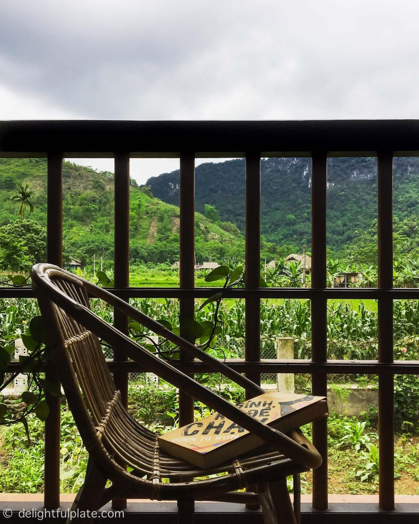View of mountains, paddy fields and garden from the dining room at Xoi farmstay, Yen Bai