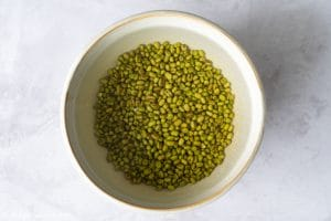 Soak whole mung beans