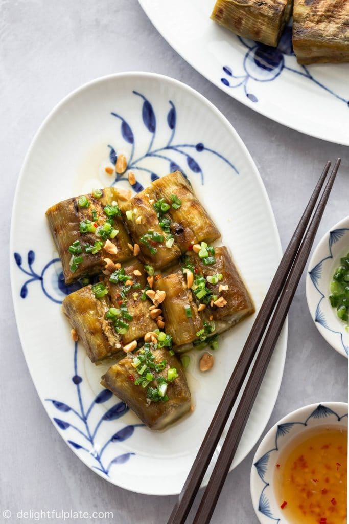 Vietnamese Grilled Eggplant with Scallion Oil (Ca Tim Nuong Mo Hanh) features whole eggplants grilled until charred and served with fragrant scallion oil, fish sauce dressing and roasted peanuts.