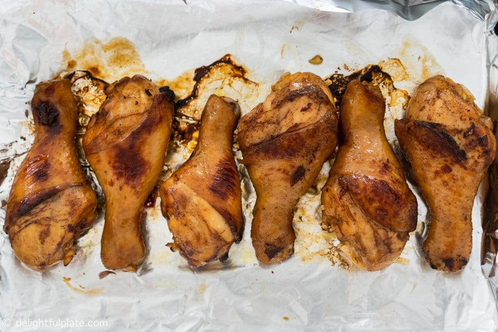 Chicken drumsticks after being briefly fried/broiled until the outside is golden.