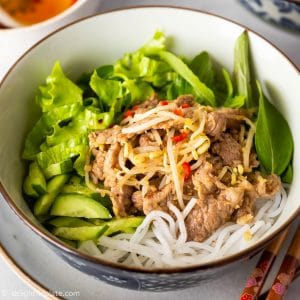 A bowl of Vietnamese noodle salad with stir-fried pork, beansprouts, lettuce and herbs