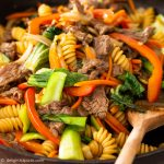 a pan with freshly-cooked Vietnamese style pasta with beef (Nui xao bo)