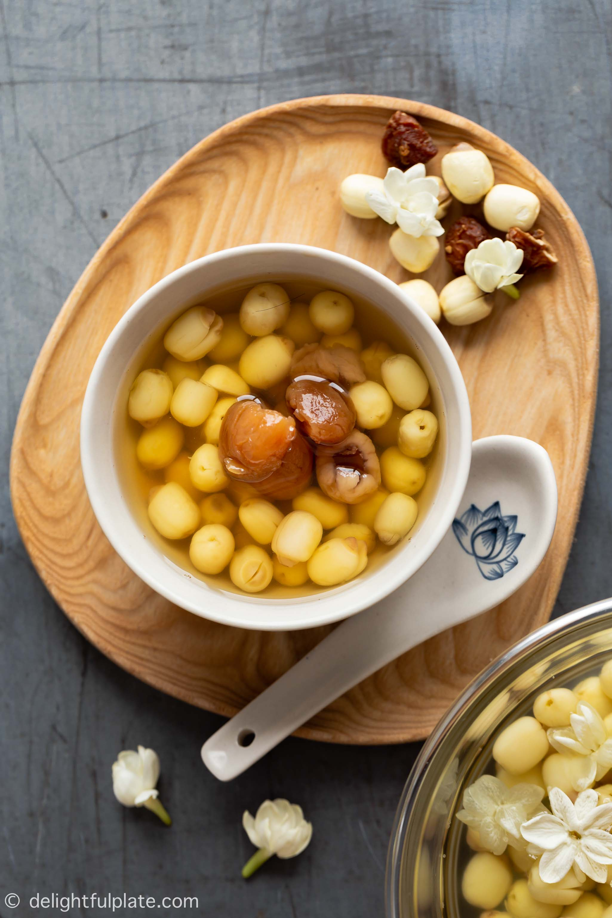 a serving bowl with lotus seed soup and longan