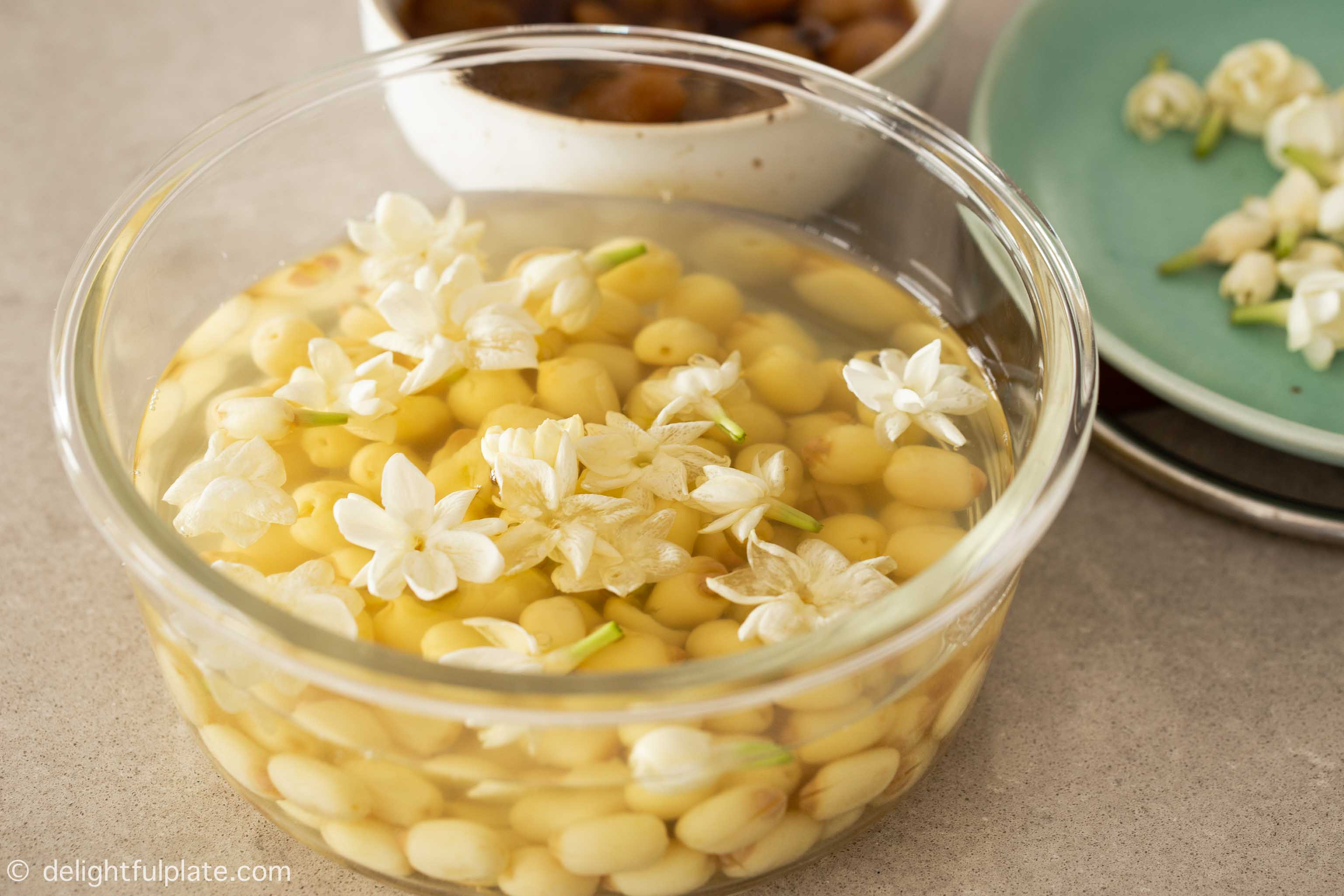 a container with lotus seed soup infused with jasmine flowers fragrance