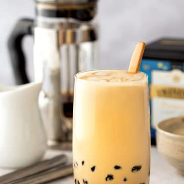 A glass of brown sugar milk tea with tapioca pearls