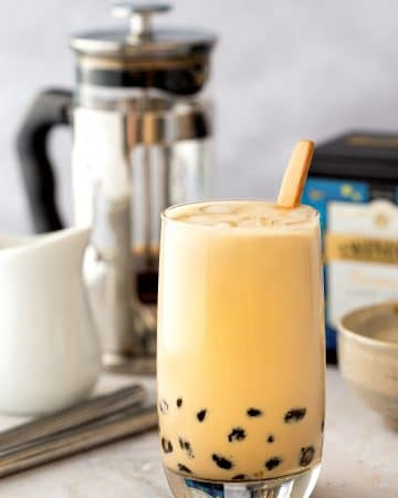 A glass of brown sugar milk tea with tapioca pearls