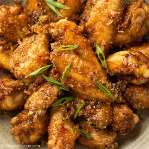chicken wings coated with lemongrass sauce on a plate
