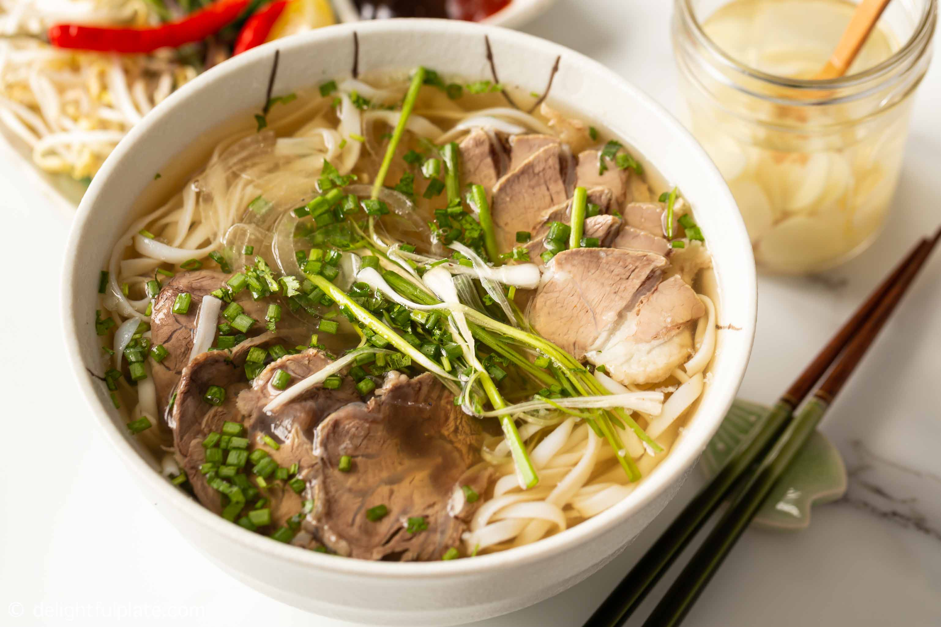 a bowl of beef pho noodle soup