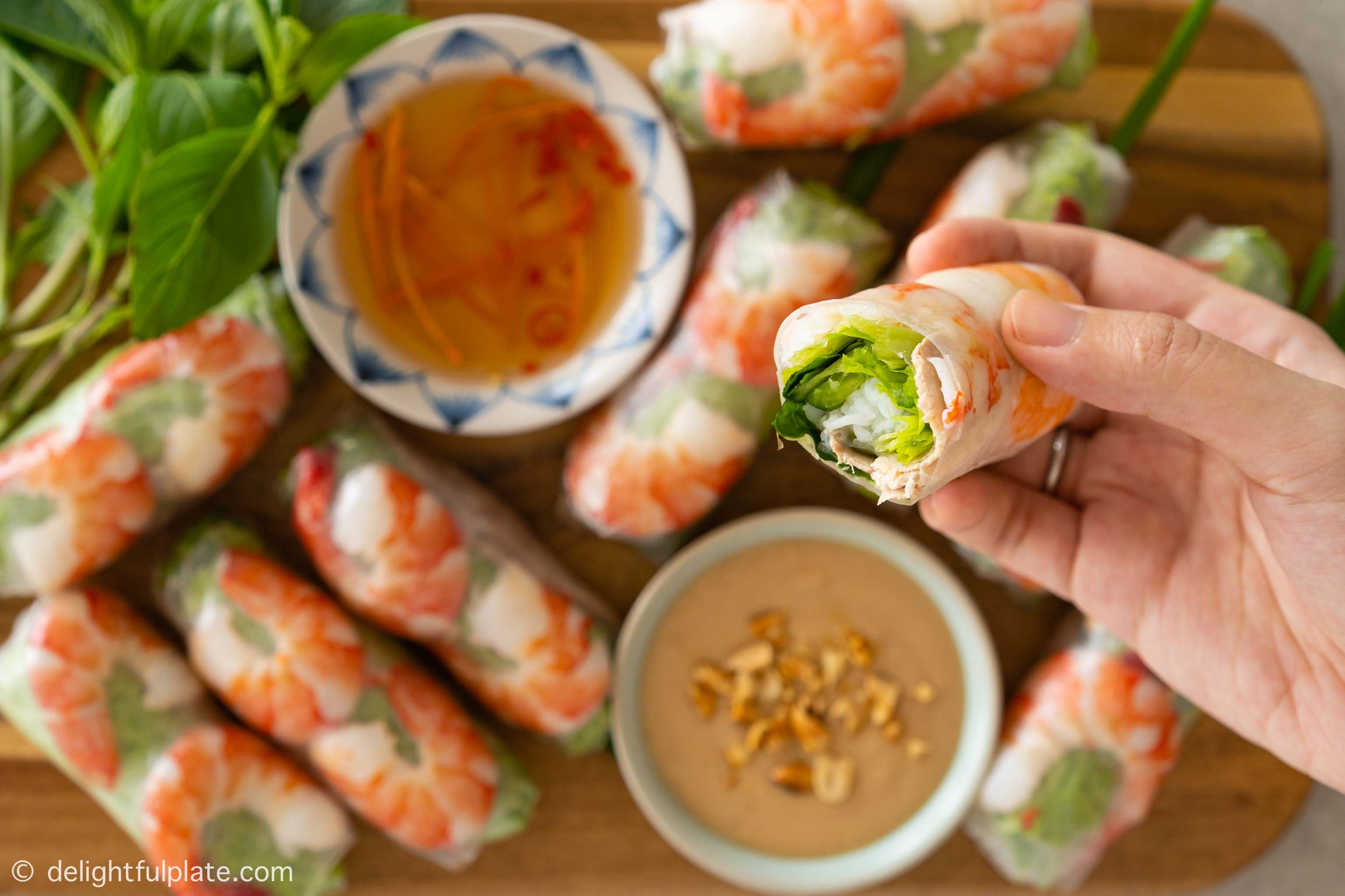 a Vietnamese spring roll consists of pork, shrimp, vermicelli noodles, lettuce and herbs