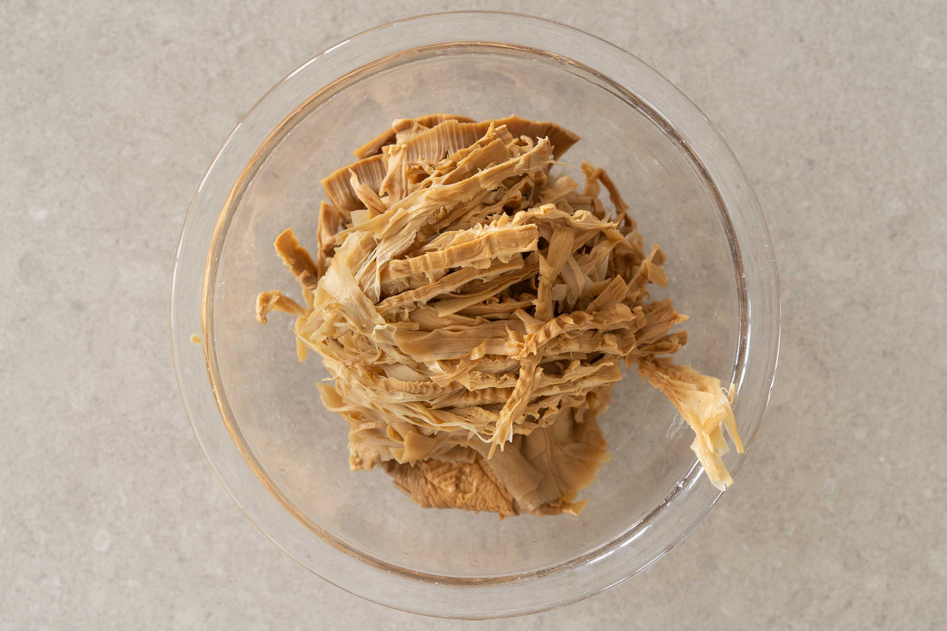 a bowl of shredded soaked bamboo shoots