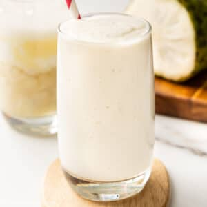a glass of soursop smoothie