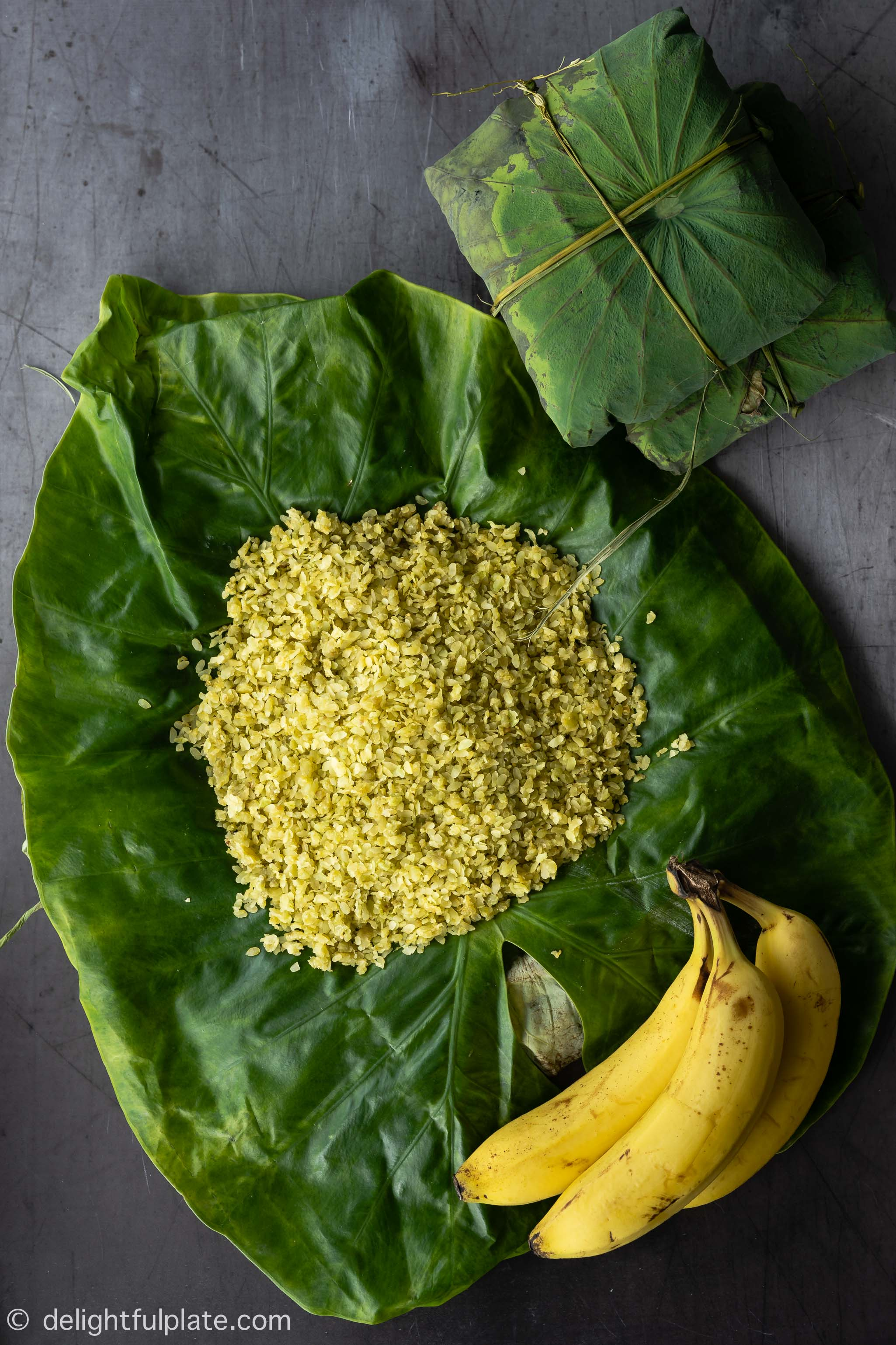a small pile of Vietnamese young green rice on top of lotus leaf