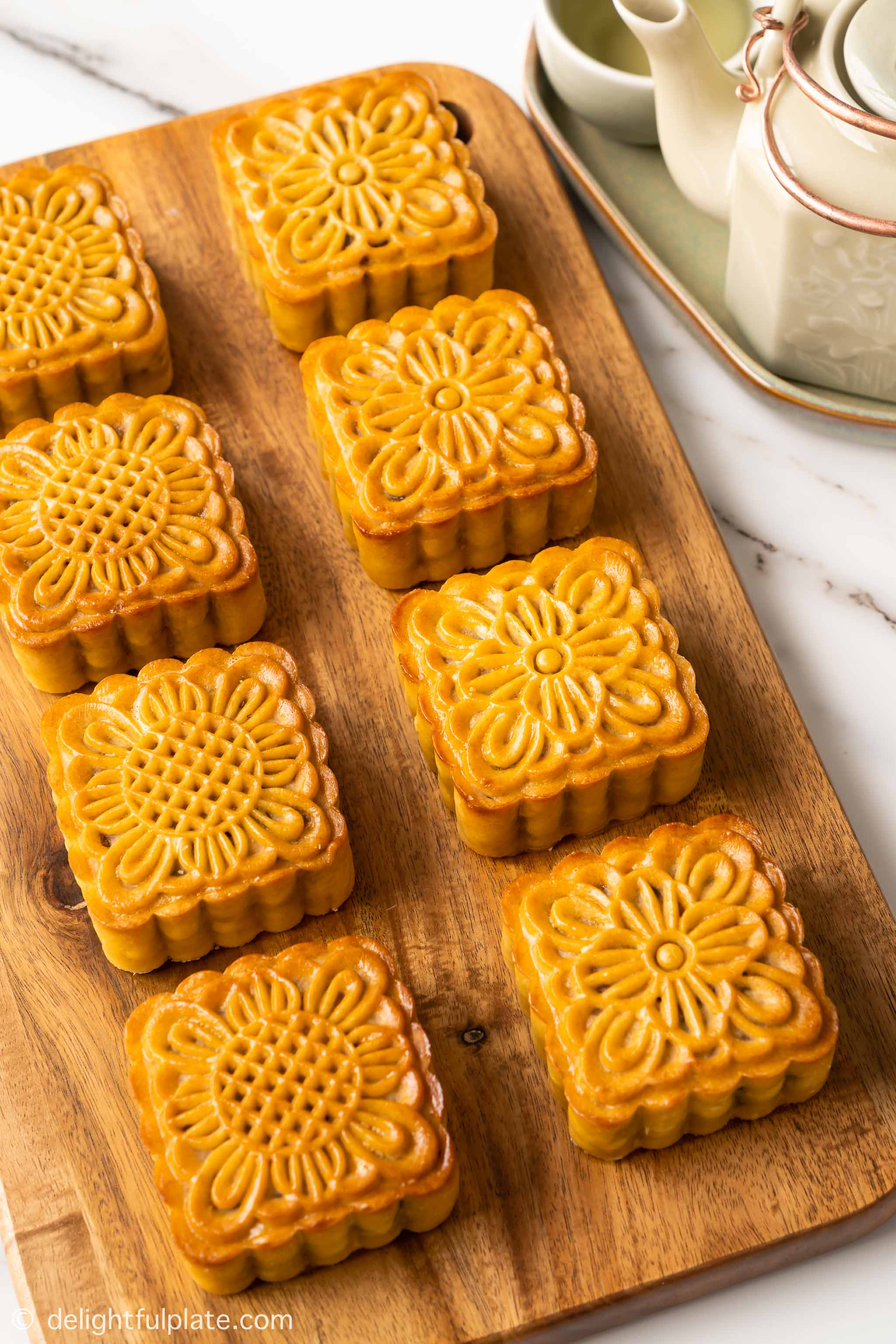 eight mooncakes on a tray