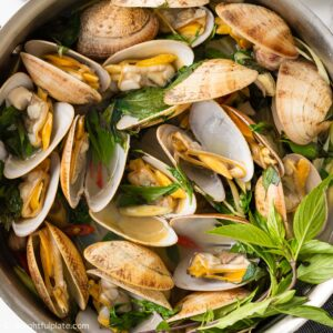 a skillet of steamed clams with Thai Basil and lemongrass