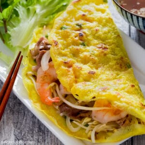 a Vietnamese crepe (Banh Xeo), served with lettuce and herbs