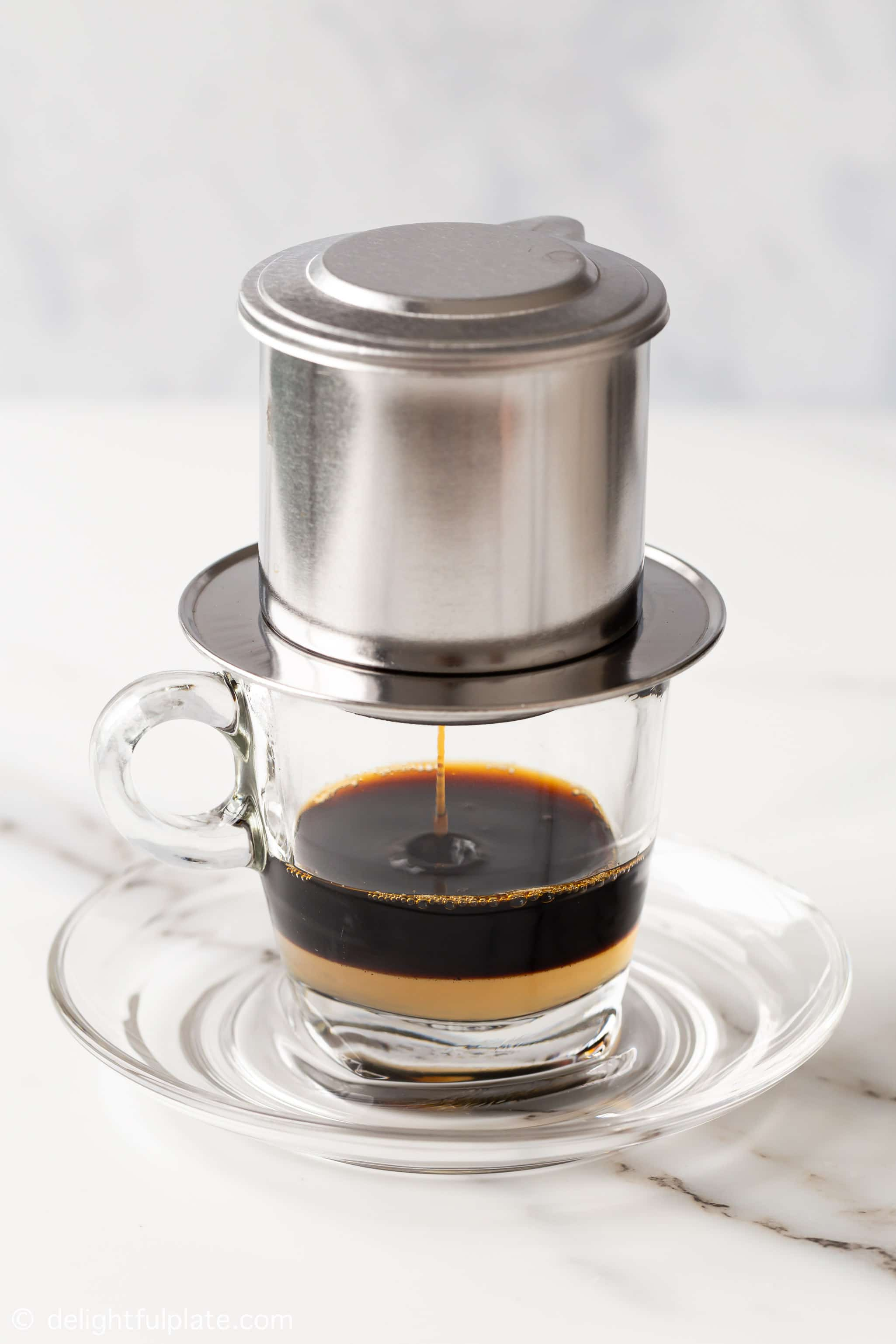 brewing Vietnamese coffee into the serving glass