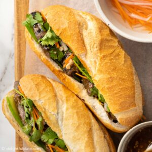 a loaf of Vietnamese Banh mi filled with grilled lemongrass beef, pickled veggies and cilantro