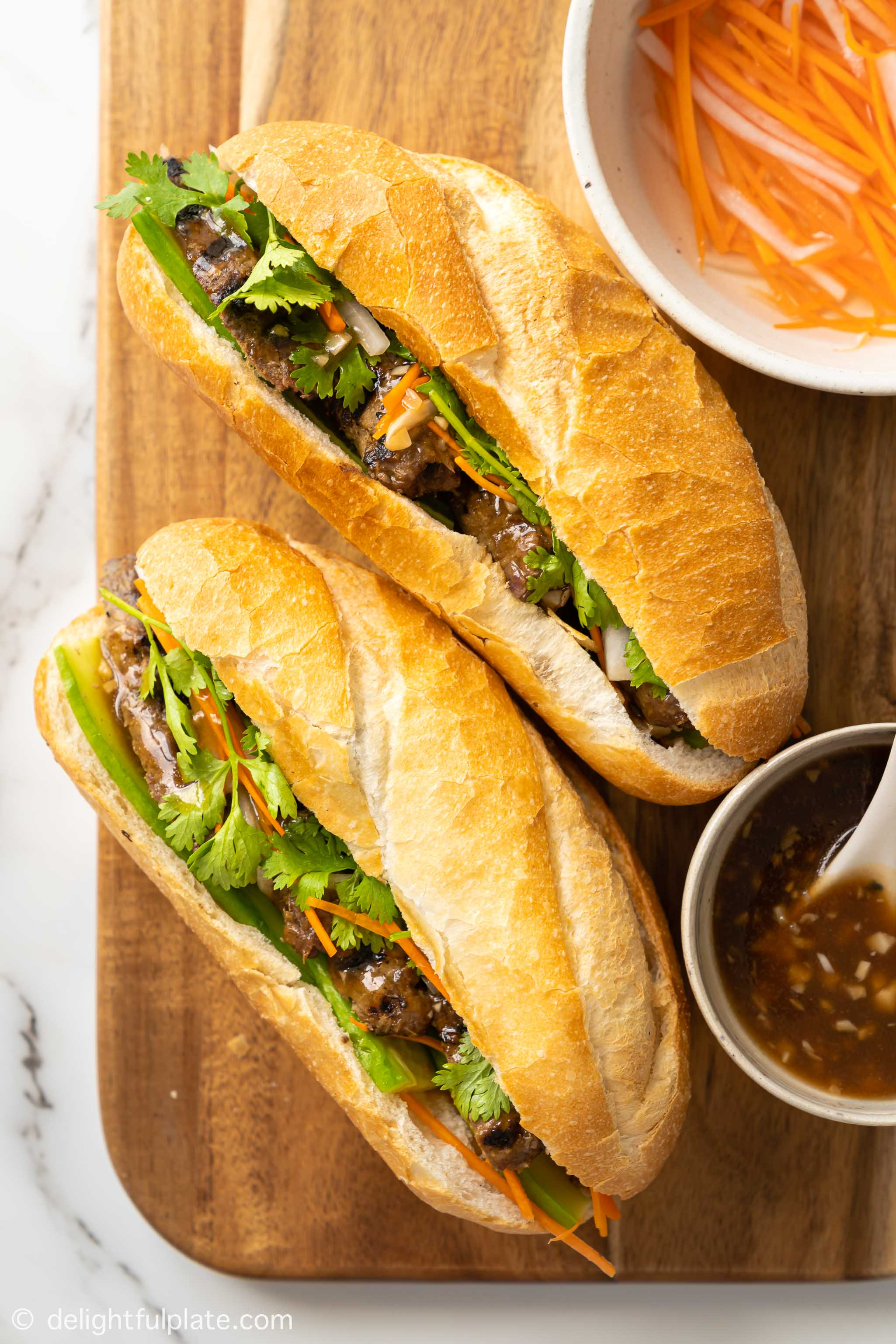 two loaves of Vietnamese lemongrass beef Banh mi