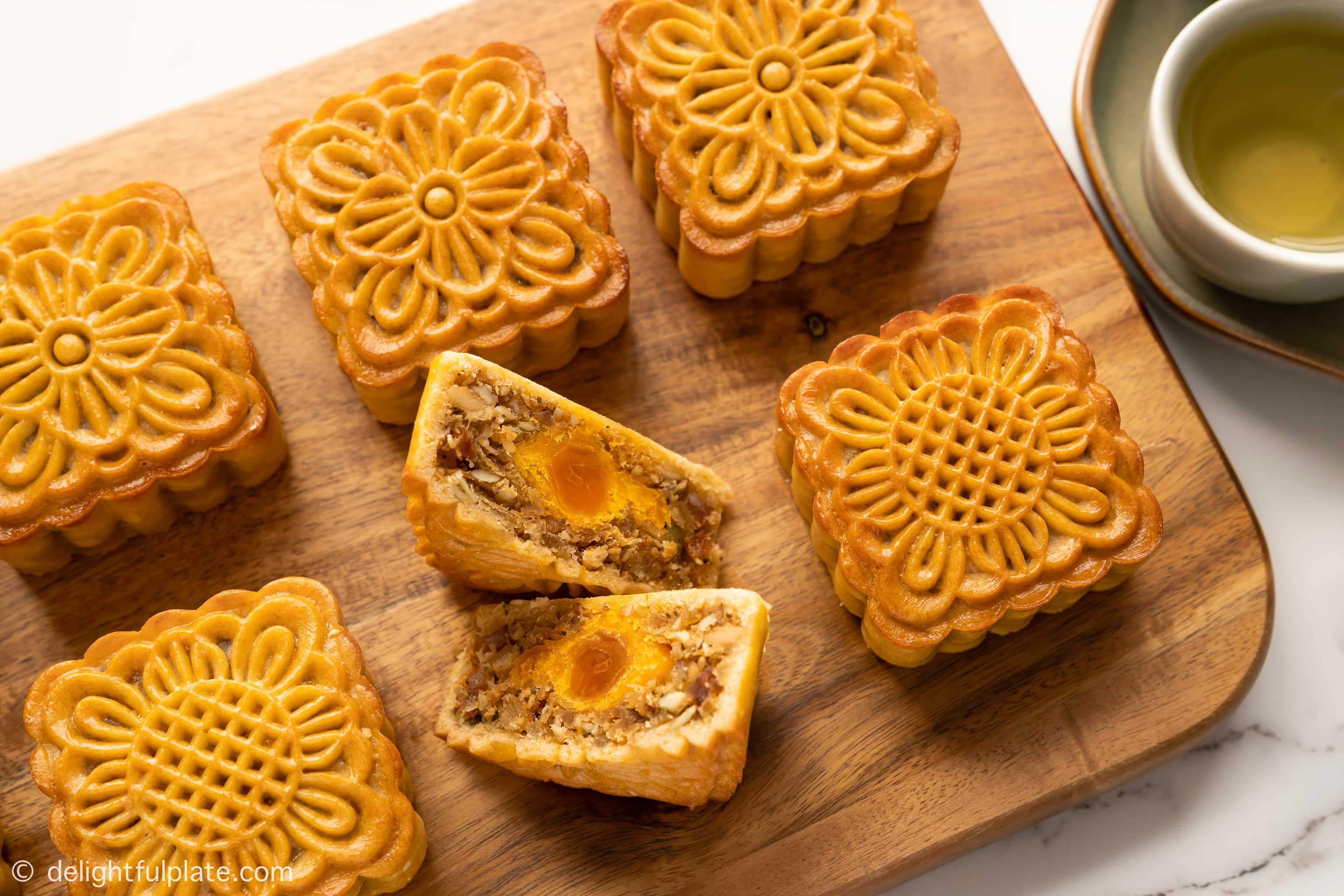 a cut slice of Vietnamese mooncakes with mixed nuts