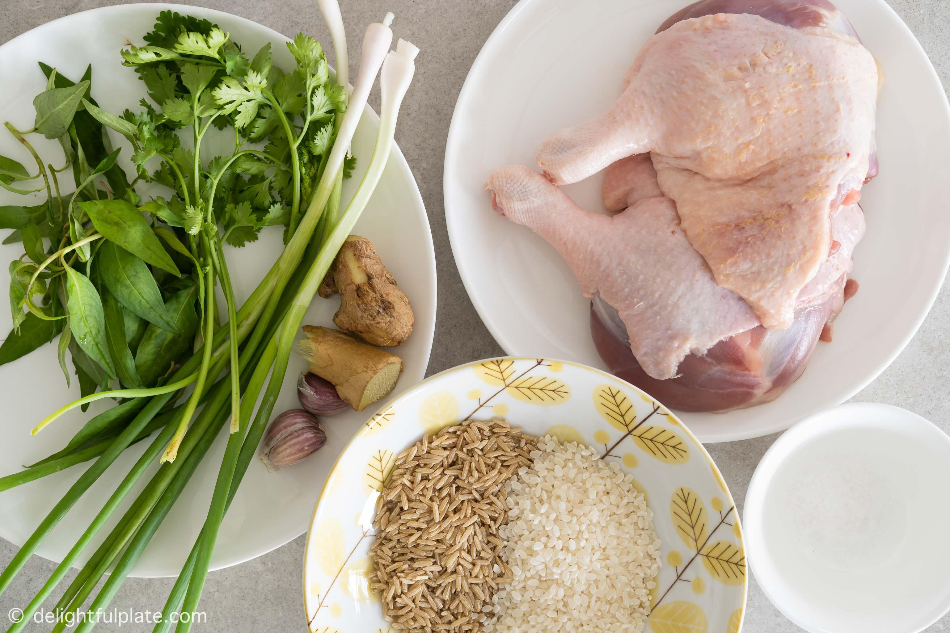 plates with ingredients to cook duck rice porridge