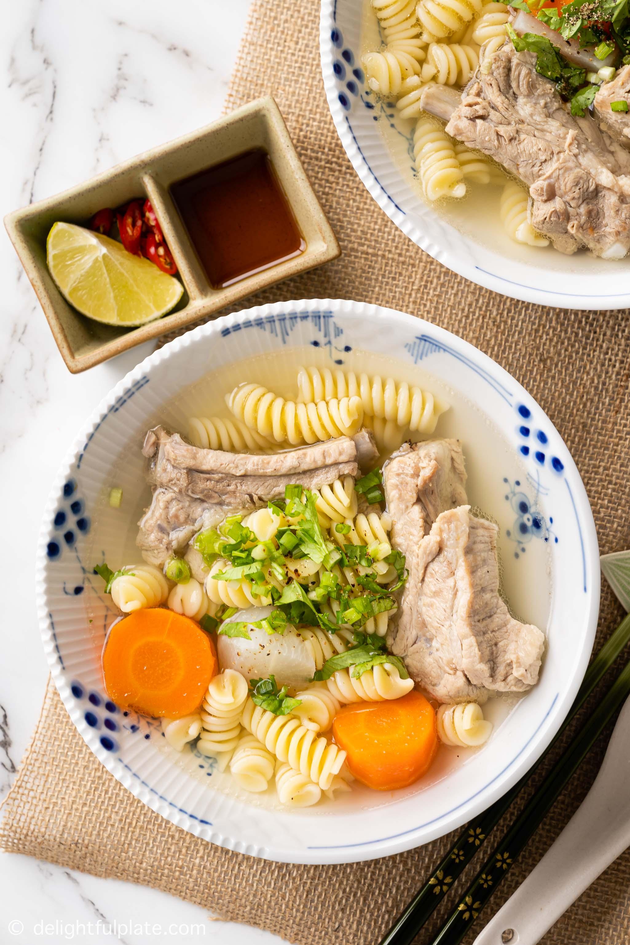 a bowl of Vietnamese macaroni soup with pork ribs