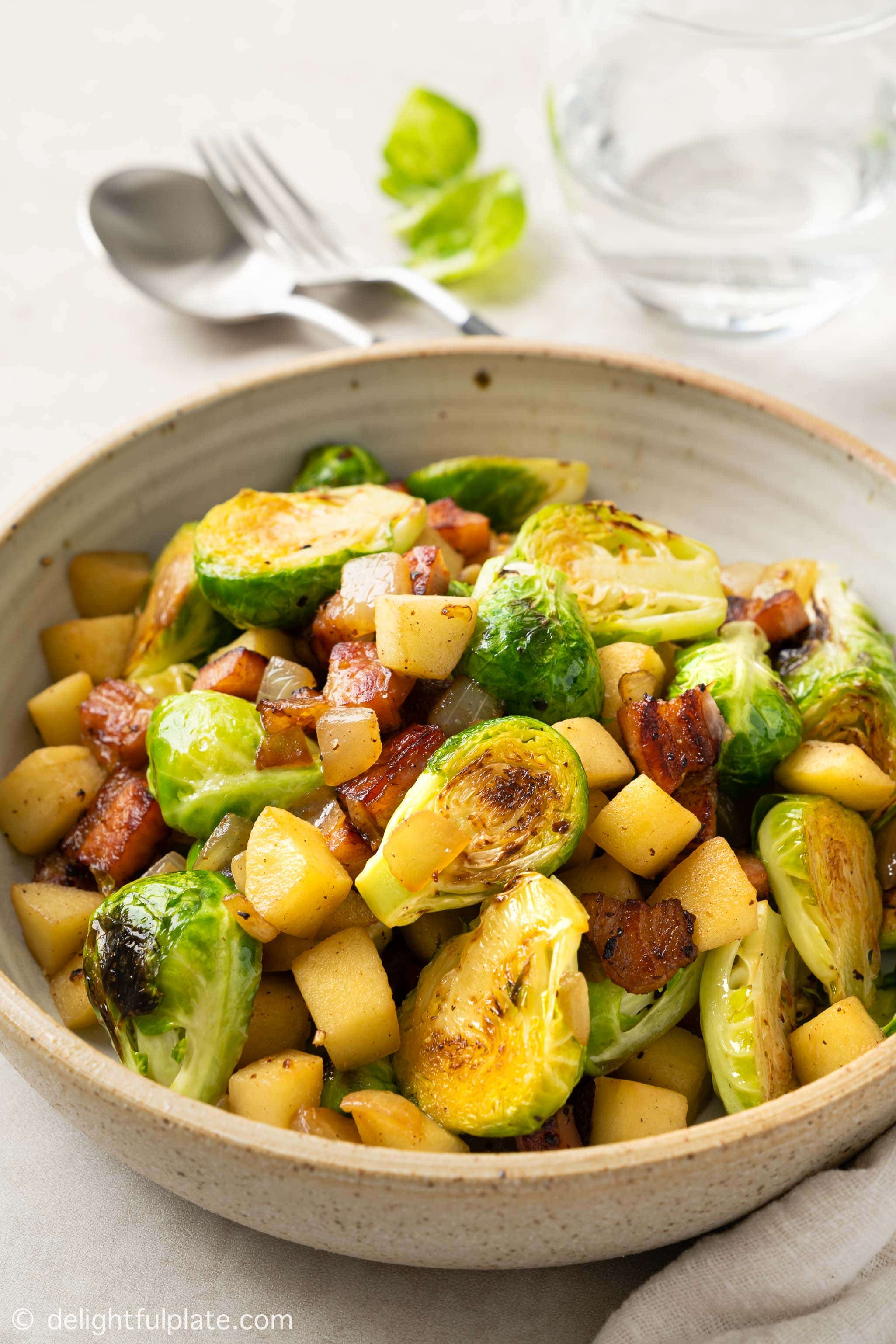 a bowl of Sautéed Brussels Sprouts with Bacon and Apple