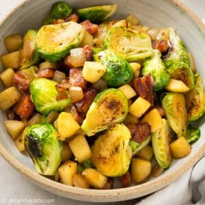 a bowl of sautéed Brussels sprouts, bacon and apple