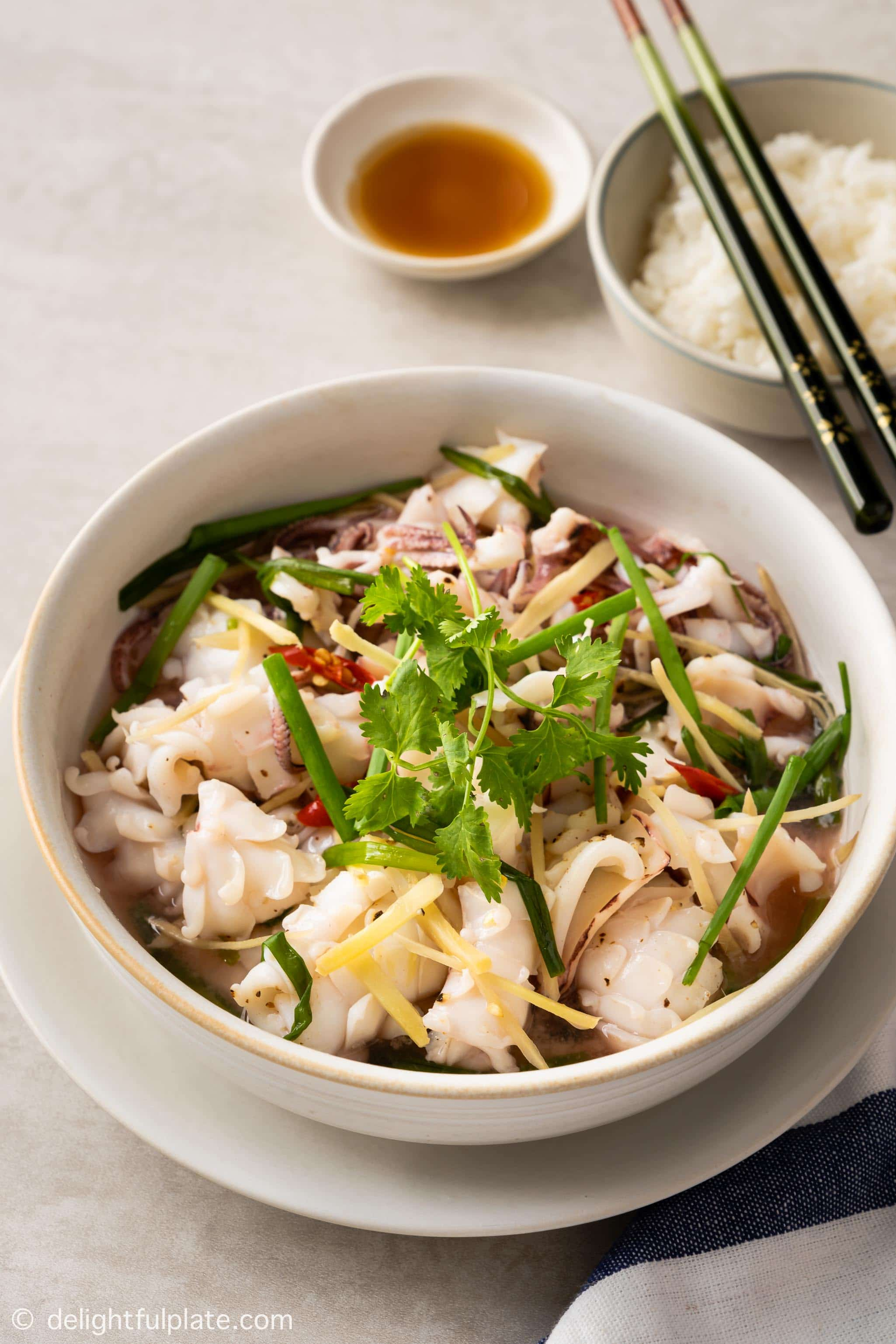 a bowl of steamed squid, served with fish sauce and rice