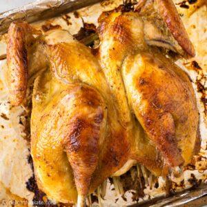 a lemongrass roast chicken on a baking sheet