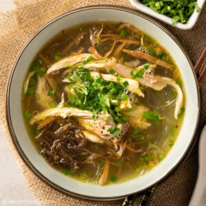 a bowl of Vietnamese chicken glass noodle soup with bamboo shoots