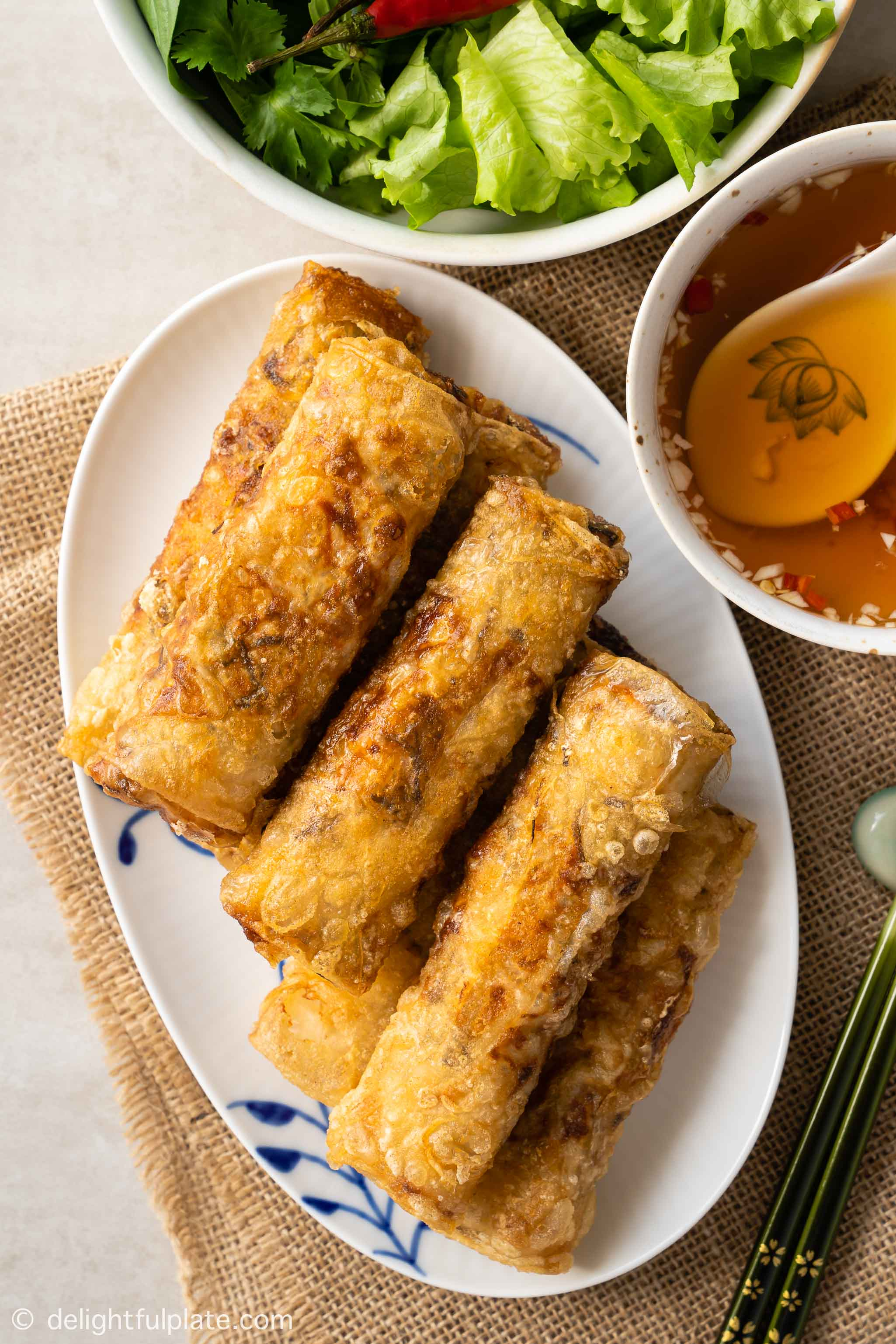 a plate of Vietnamese crispy spring rolls, served with dipping sauce