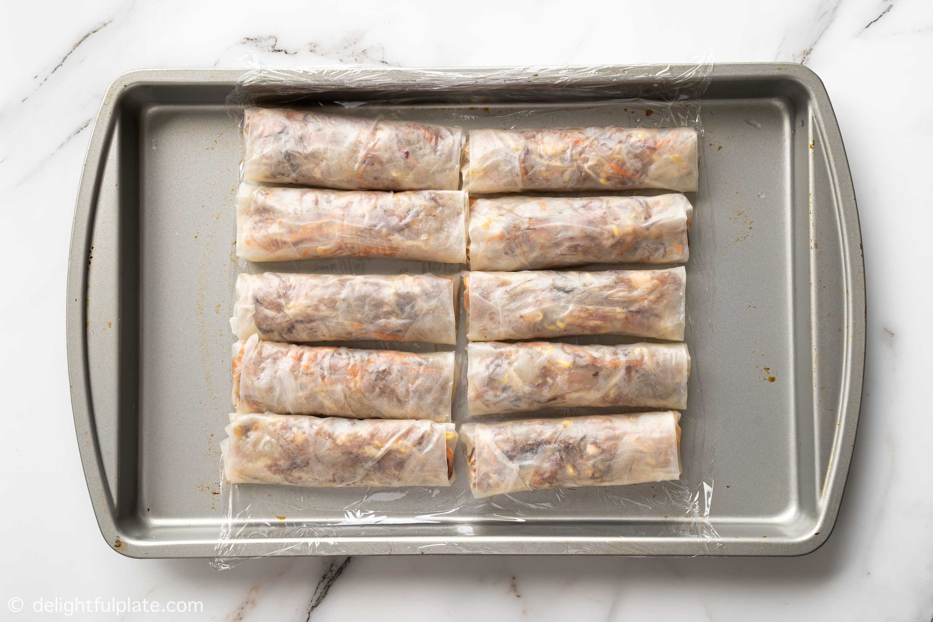 a tray of spring rolls that haven't been fried