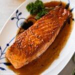a glazed salmon fillet on a serving plate
