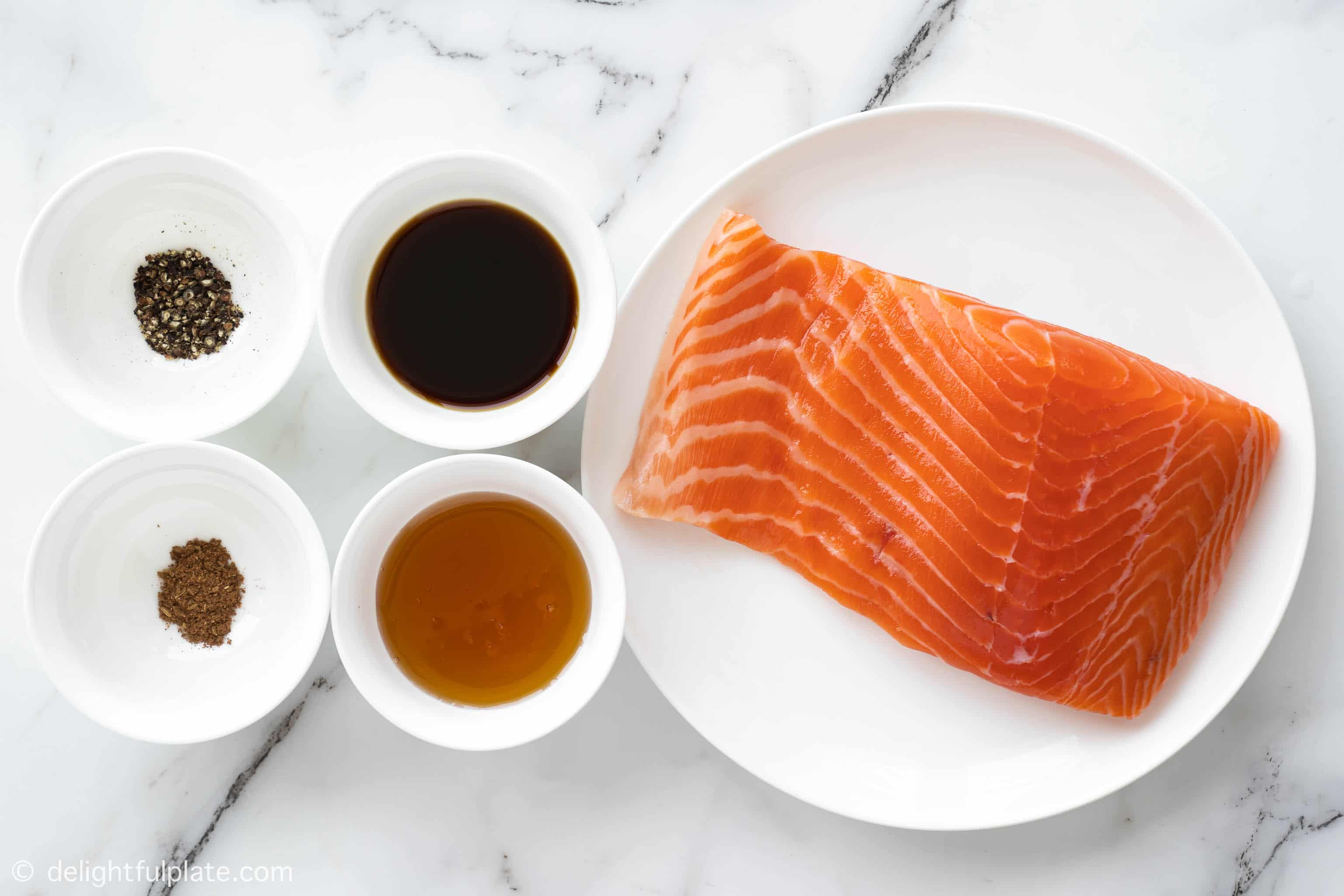 plates with ingredients for glazed salmon
