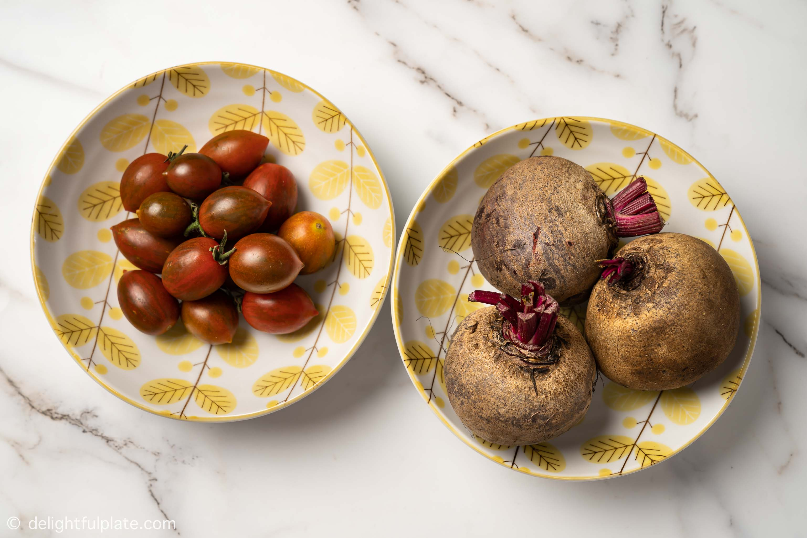 plates with beetroots and cherry tomatoes
